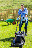 Man lawn mowing — Stock Photo