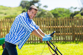 Man pushing lawnmower — Foto Stock