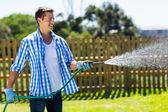 Man watering garden — Stock Photo