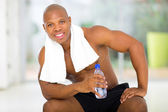 Afro american man after exercising in gym — ストック写真