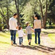 Young family walking in forest — Foto Stock