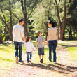 Young family walking in forest — Stockfoto