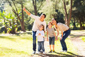 Family bird watching in forest — Stock Photo