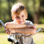 Little boy on bicycle — Stock Photo #47157571