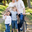 Young family of four outdoors — Stock Photo #47157619