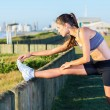 Woman stretching at beach — Stock Photo #47157673