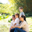 Happy family of four by pond — Stock Photo #47157775
