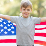 Little boy holding american flag — Stock Photo