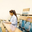 Student using laptop in lecture hall — Stock Photo