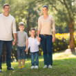 Young family standing outdoors — Stock Photo #47158135