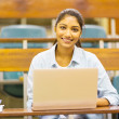 Indian college student using laptop — Stock Photo