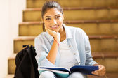 Indian college girl sitting on stairs — Stock Photo