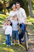 Young family of four outdoors — Stock Photo