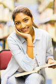 Indian student in library — Stock Photo