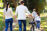 Family walking outdoors — Stock Photo