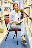 Female student reading in library — Stock Photo
