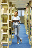 College girl in library — Stock Photo