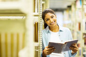 Female college student in library — Stock Photo
