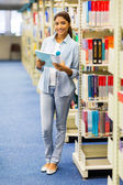 Female university student in library — Stock Photo