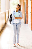 Indian college girl holding books — Stock Photo