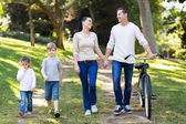 Couple and kids walking outdoors — Foto Stock
