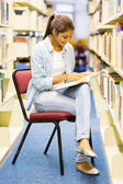 Indian university girl studying in library — Stock Photo