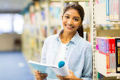 Indian college girl reading book — Stock Photo