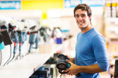 Man purchasing hand tool — Stock Photo