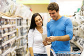 Couple in hardware store — Stock Photo