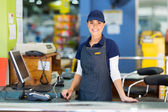 Woman working as a cashier — Stock Photo