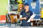 Female cashier at store — Stock Photo