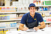 Hardware store worker making notes — Stock Photo