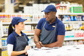 Supermarket colleagues talking — Stock Photo