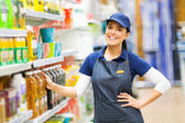 Saleswoman standing in store — Stock Photo