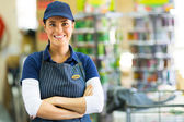 Store employee with crossed arms — Stock Photo