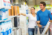 Couple shopping at hypermarket — Stock Photo
