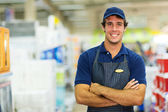 Salesman standing in hardware store — Stock Photo