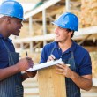 Workers working in timber yard — Stock Photo