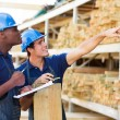 Workers in timber department — Stock Photo