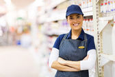Shop assistant with crossed arms — Stock Photo