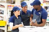 Store workers discussing — Stock Photo