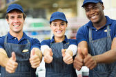 Workers showing thumbs up — Stock Photo