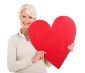 Senior woman with heart shape — Stok fotoğraf