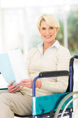 Disabled woman reading book — Stock Photo