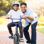 Indian boy learning ride bike — Stock Photo #49179569