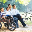 Indian family relaxing in park — Stock Photo #49179601