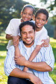 Happy indian father and kids — Stock Photo