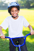 Indian boy riding bicycle — Stock Photo