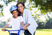 Mother teaching daughter ride bike — Stock Photo