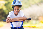 Little indian girl on bike — Stock Photo